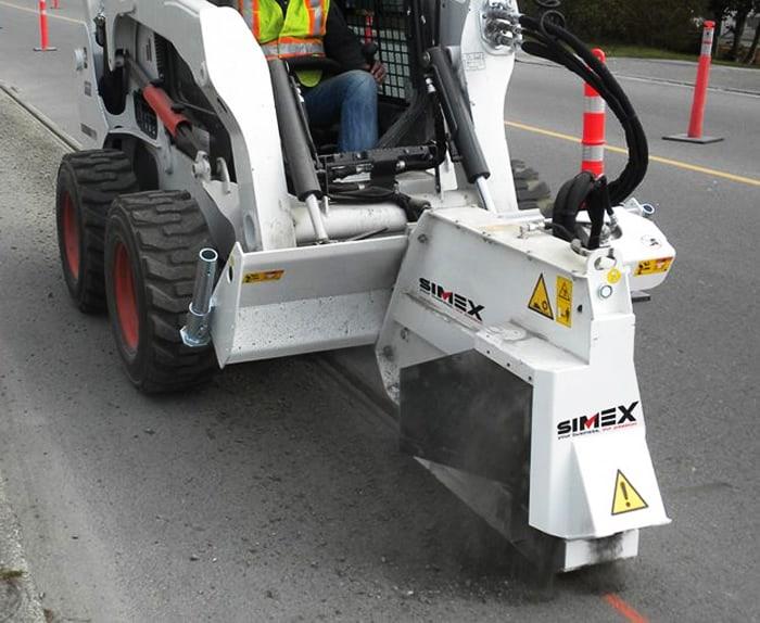 a simex wheel saw on a road