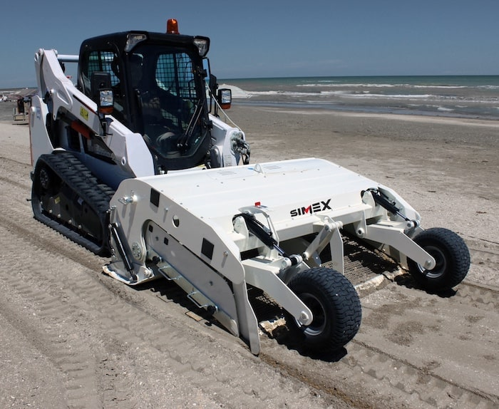full view of a beach cleaner on a beach