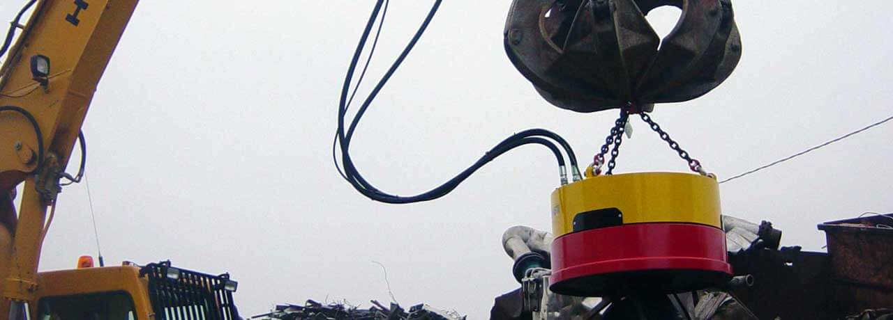 Recycle Solutions - Magnet on an excavator picking up metal at a work site